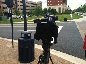 A camera sits idling on National Harbor's sidewalk after security told News 4 it couldn't film without prior approval